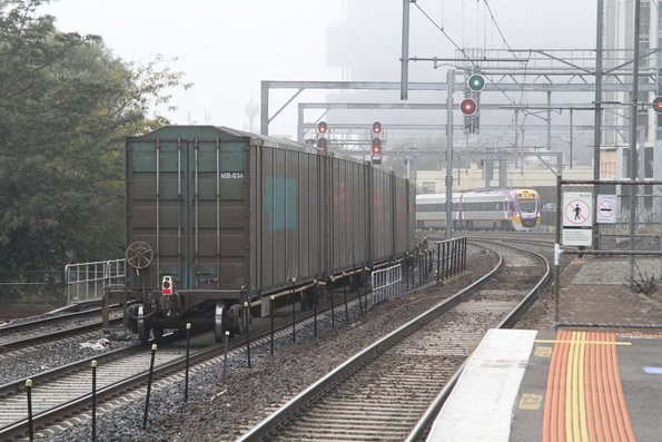 Toll car carrier containers at the tail end of AM5 up freight through Middle Footscray