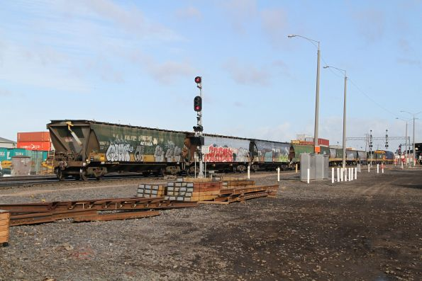 8115 shunts standard gauge grain wagons out of the Melbourne Freight Terminal