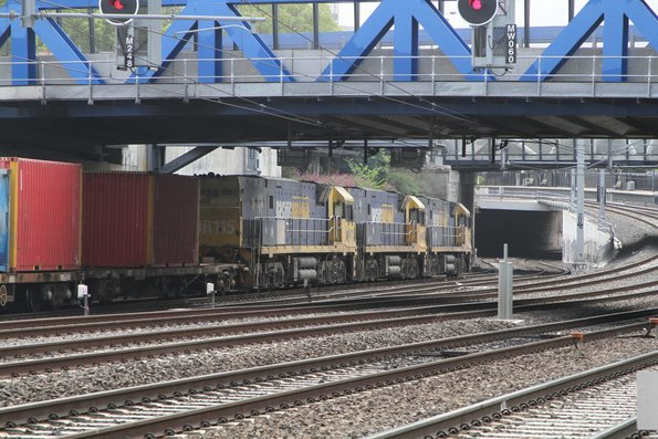 NR61 leads NR92 and NR115 on an up freight at Middle Footscray