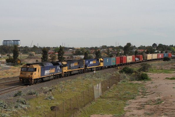 AN5 leads NR94 and NR82 on a late running Pacific National 7BM4 service through Albion