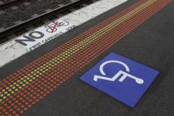 'No bikes in first carriage door' notice at the end of the platform