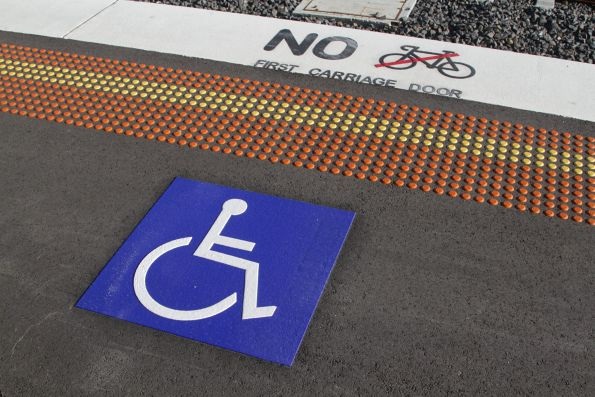 'Wheelchairs here / no bikes first carriage door' sign at West Footscray station