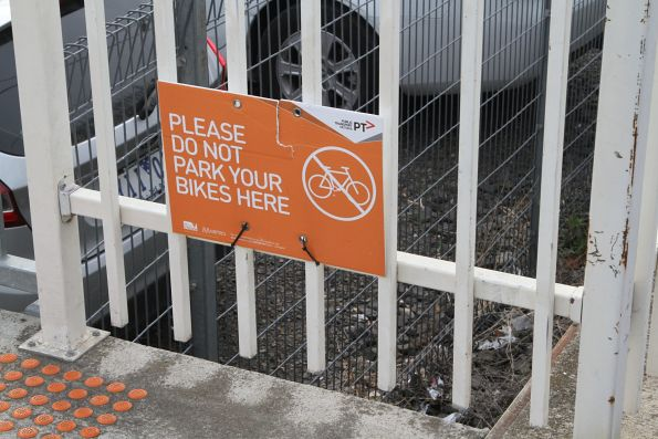 'Please do not park your bike here' sign at Coburg station