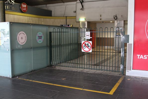 'No bikes' sign at the emergency exit from Flinders Street platform 12 and 13