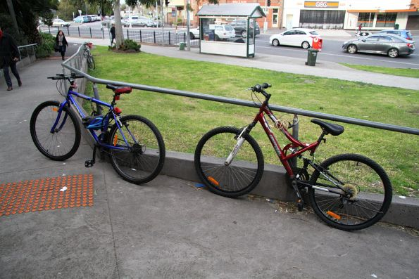 Bikes locked up to the handrails outside North Williamstown station
