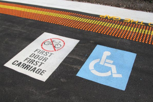 'No bikes first door first carriage' sign on the platform at Werribee station