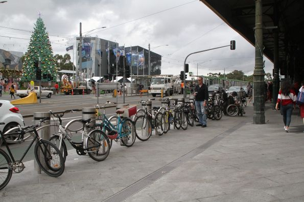 Bikes locked up to the new racks cum security bollards outside Flinders Street Station