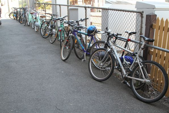 Bikes locked up to the fence at North Brighton platform 1