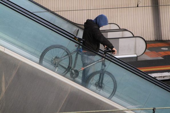 Taking a bike down the escalators at North Melbourne station