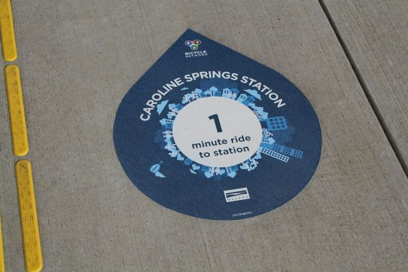 Bicycle Network / City of Melton '1 minute ride to the station' sticker at Caroline Springs station
