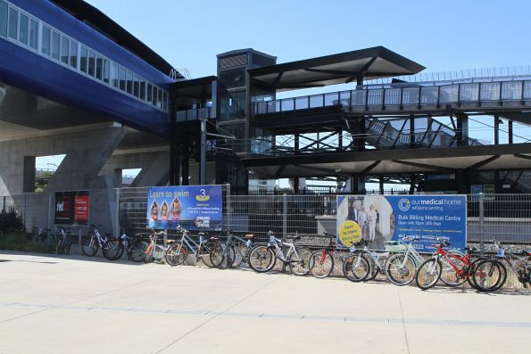 Row of bikes chained to the fence at Williams Landing station