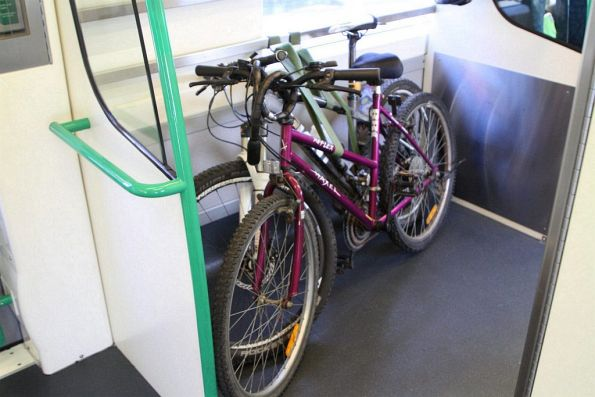 Pair of bikes stowed away onboard this VLocity train