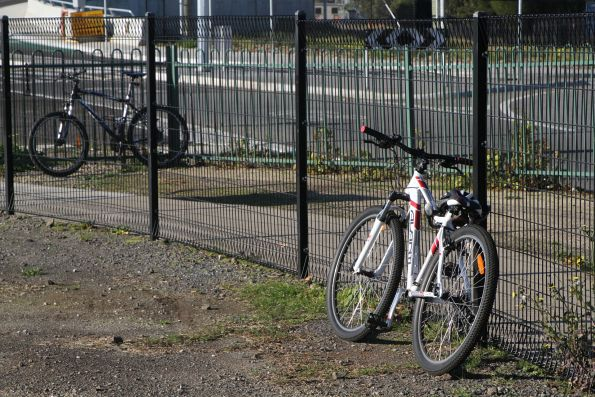 Bikes locked up to the car park fence at Aircraft station