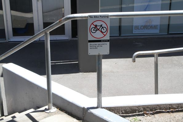 'No bike parking' signage on the concourse railings at Elsternwick station