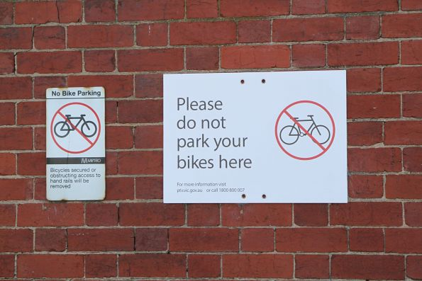 Pair of 'please do not park your bike here' signs at Caulfield