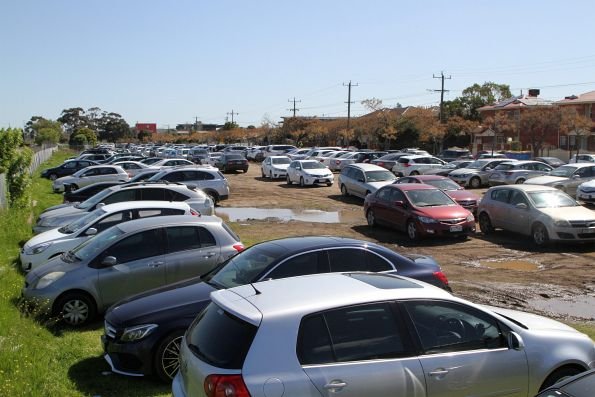 Cars parked in the mud at Tottenham, due to the closure of the West Footscray station car park for Metro Tunnel works