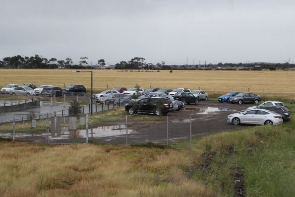 Cars parked in the mud around Tarneit station