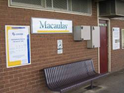 Five different styles of signage at Macaulay station