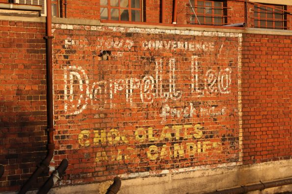 Old painted Darrell Lea sign in Footscray