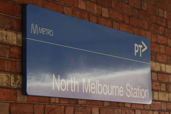Metlink-styled 'North Melbourne' text hides beneath the new PTV branding that was painted over the top