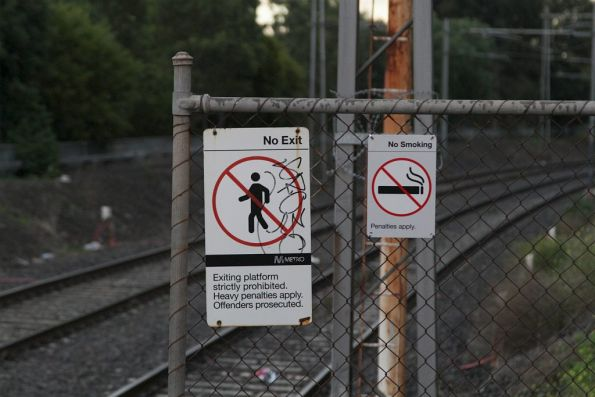 New 'No Smoking / Penalties apply' sign on the platform at a suburban railway station