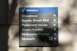 Very out of date 'Museum Station' on directional signage in the Melbourne CBD