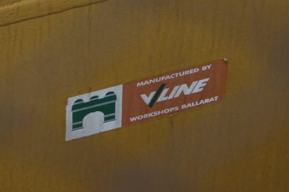 'Manufactured by V/Line Workshops Ballarat' sticker on a bridge protection beam