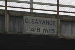'Clearance 4.8m' sign on the Warrigal Road bridge at Oakleigh