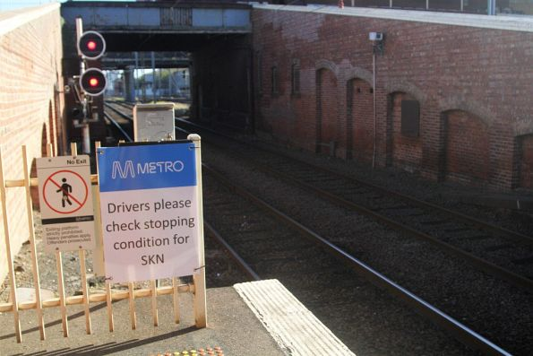 'Drivers please check stopping condition for SKN' notice at the departure end of North Melbourne platform 6