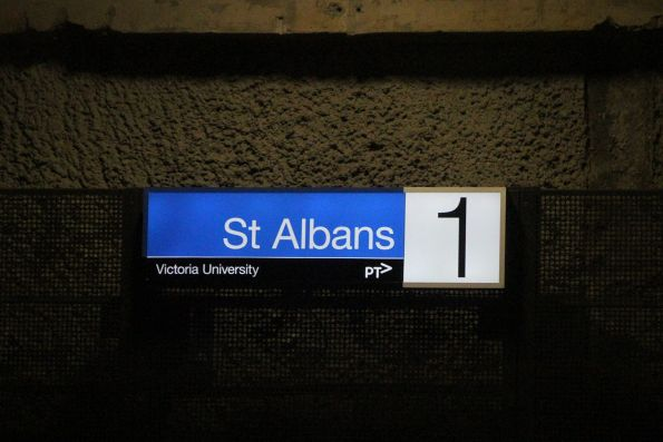 'Victoria University' subtext beneath the illuminated station sign at St Albans