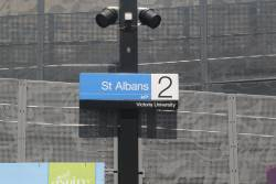 'Victoria University' subtext beneath the station sign at St Albans