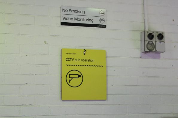 Fold down 'CCTV is in operation' sign in the Macleod station waiting room