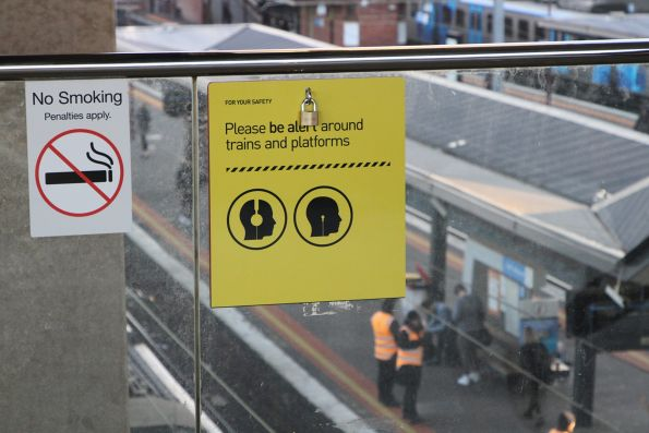 'Please be alert around trains and platforms' sign at North Melbourne