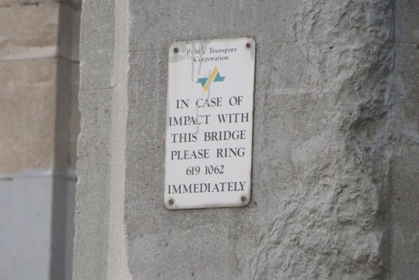 Public Transport Corporation branded 'in case of impact with this bridge' sign