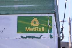 MetRail logo with trefoil on a demountable railway building