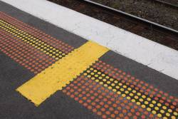 Yellow bar on the platform is the stopping mark for up trains