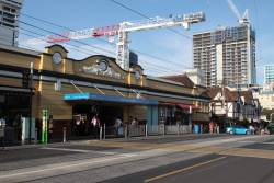 Hundreds of new apartments crowd the skyline at South Yarra, and a lone station entrance struggles to cope with commuters