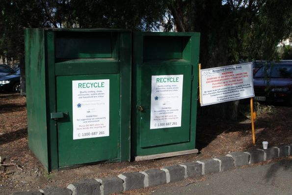 Clothing recycling bins in a railway station car park