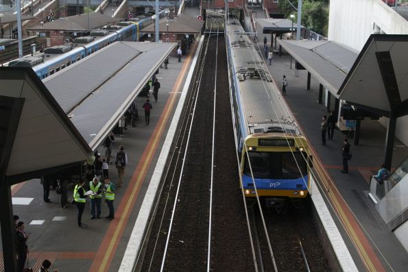 Temp staff at North Melbourne count passengers on outbound trains in evening peak