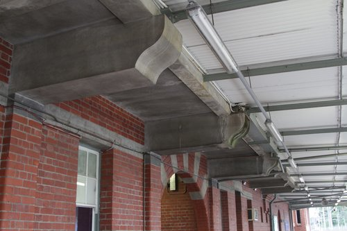 Original condition cantilevered concrete beams on the south side of Camberwell station