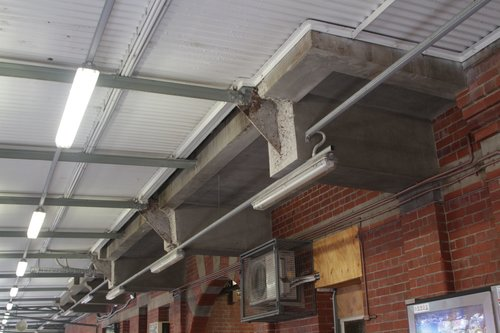 Rehabilitated cantilevered concrete beams on the north side of Camberwell station