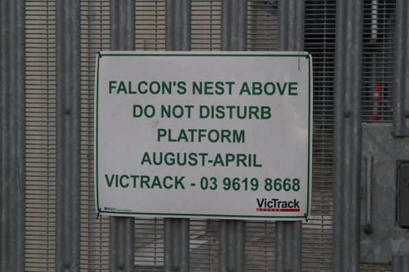 Warning notice of a falcon's nest atop a VicTrack radio mast at Footscray station