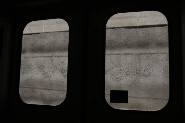 Looking out at a concrete wall at Springvale station