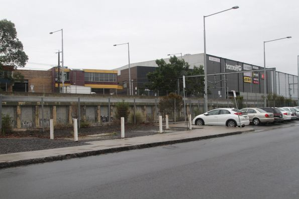 Railway emerges from under Springvale Road on the east side of Nunawading station, trench walls still visible