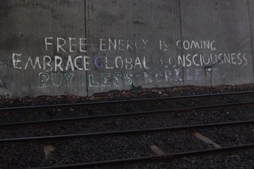 'FREE ENERGY IS COMING EMBRACE GLOBAL CONSCIOUSNESS' graffiti at Camberwell