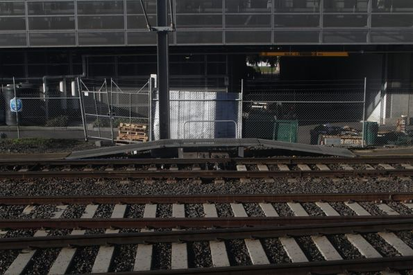 Metal walkway crosses over a point motor at Flinders Street Station