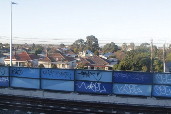 Looking out over suburban houses from the rail embankment at Tottenham station