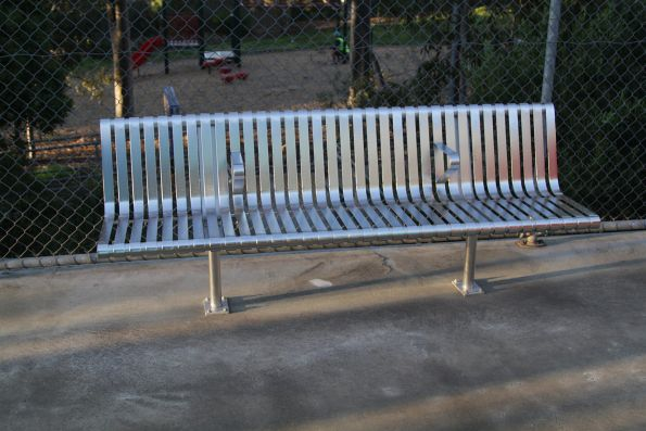 New metal benches installed across the suburban network - with armrests that prevent anyone from laying down on them