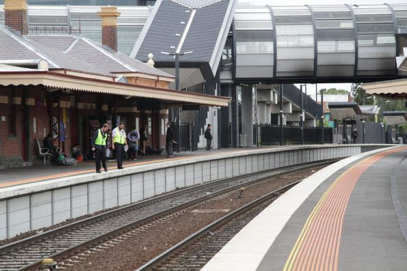 V/Line staff at Footscray also looking onto the tracks for a missing item