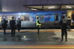 Hoban contract staff counting passengers at North Melbourne station